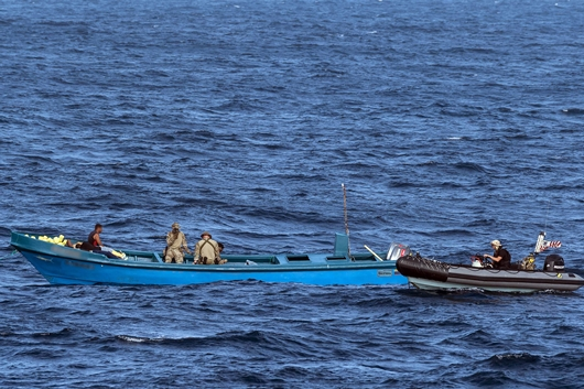 Crewmembers from HMCS EDMONTON and members from the U.S. Coast Guard Law Enforcement Detachment (LEDET) conduct a narcotics seizure during Operation CARIBBE, 20 November 2018.