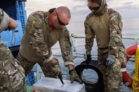 US Coast Guard Law Enforcement Detachment (LEDET) members proceed to test and assess the drug packages recovered during Operation CARIBBE on 6 November 2018.
